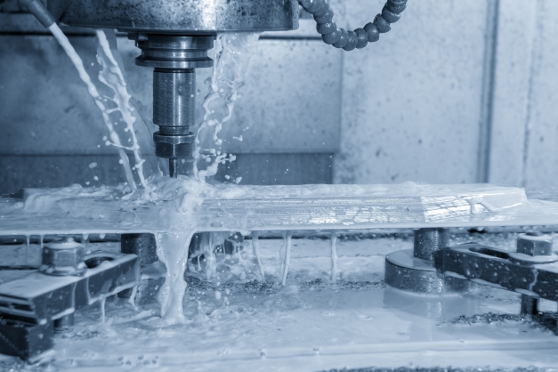 The CNC milling machine water jet cutting the mold part by solid radius end mill tool.
